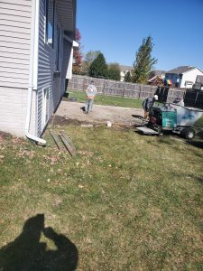 workers constructing concrete patio