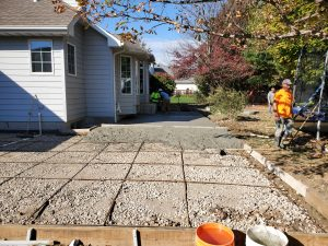 workers putting cement on the patio