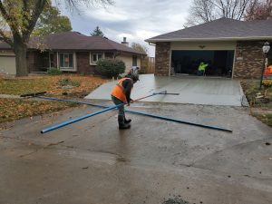 contractor finishing the driveway