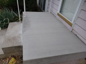 a concrete stairs on front door