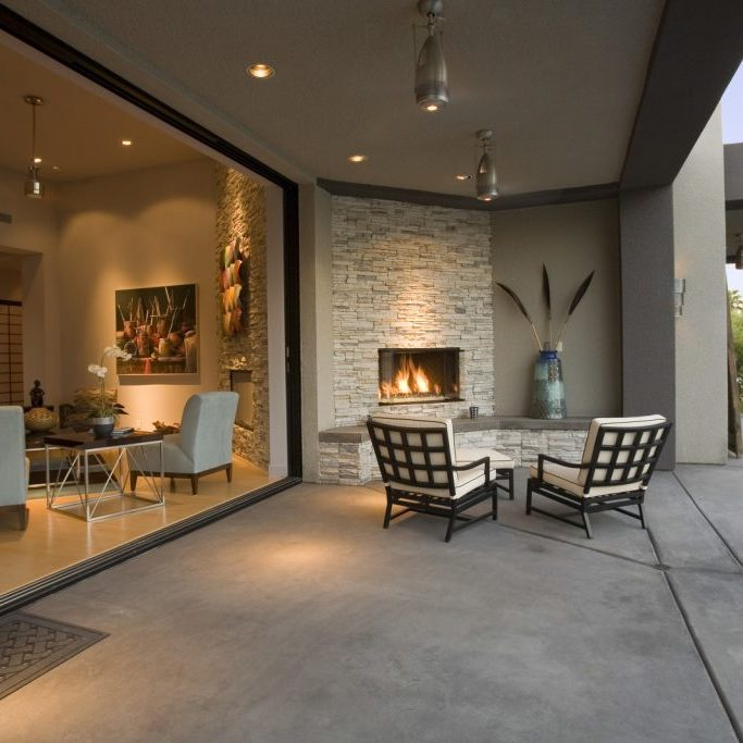 a yard with fireplace