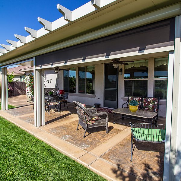 modern rear yard covered patio with furniture